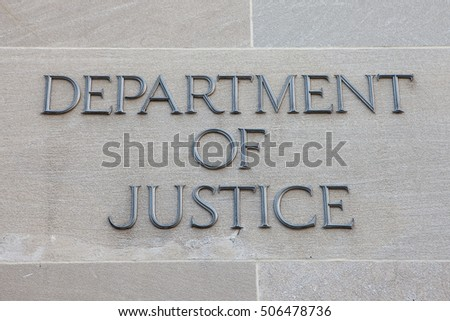 WASHINGTON, DC - SEPTEMBER 10: Sign for the Department of Justice (DOJ) in Washington, DC on September 10, 2016. The DOJ is led by the Attorney General, the nation's top law enforcement official.