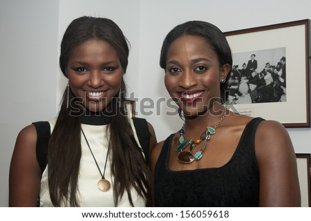 "WASHINGTON, DC - SEPTEMBER 25: Yityish (""Titi"") Aynaw, Miss Israel 2013, and Gigi Tchouaga, Miss Africa-USA 2012, visit the National Press Club, September 25, 2013 in Washington, DC  - stock photo"