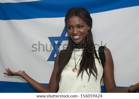 "WASHINGTON, DC - SEPTEMBER 25: Yityish (""Titi"") Aynaw, Miss Israel 2013 visits the National Press Club, September 25, 2013 in Washington, DC  - stock photo"