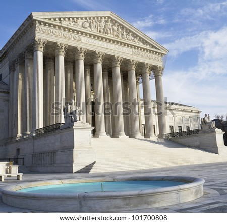 Washington DC, Supreme Court building with a blue sky background. - stock photo