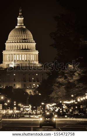 Washington DC, United States Capitol building night view from from Pennsylvania Avenue with car lights trails - Sepia  - stock photo