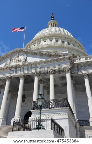 Washington DC, United States landmark. National Capitol building with US flag.