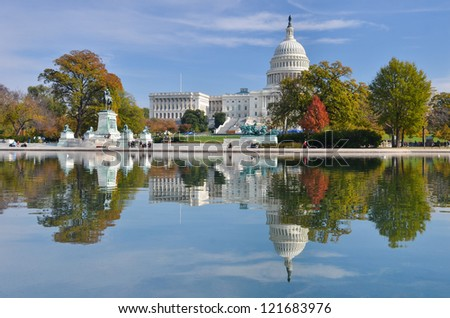 Washington DC, US Capitol Building and mirror reflection in autumn