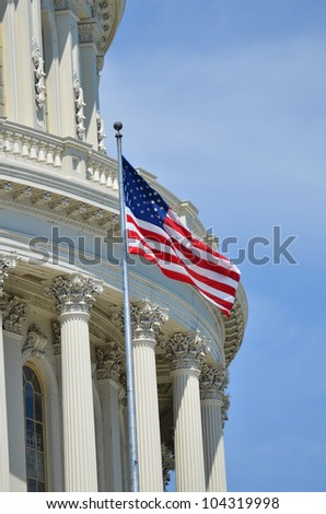 Washington DC - US Capitol Building dome detail wit flapping US flag - stock photo