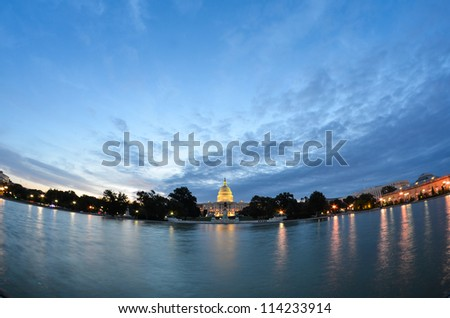 Washington DC, US Capitol Building in a cloudy sunrise - fish eye view - stock photo