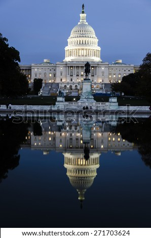 Washington DC, US Capitol Building in a cloudy sunrise with mirror reflection  - stock photo