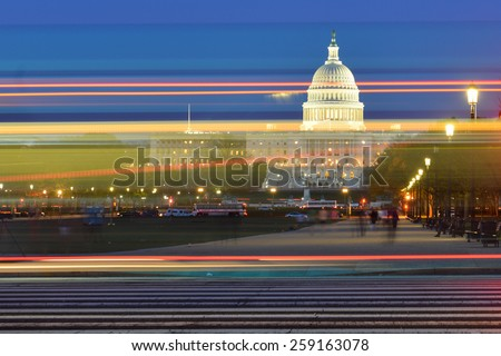 Washington DC - US Capitol Building with car lights trails foreground at night  - stock photo