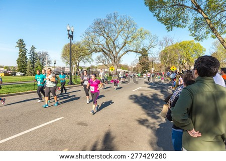 Washington DC, USA - Apr.12, 2015 : Joggers and runners participated in the event of Credit Union Cherry Blossom 5K run-walk - stock photo