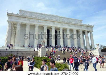 WASHINGTON DC, USA - APRIL 12, 2015: People visit Abraham Lincoln memorial in Washington. 18.9 million tourists visited capital of the United States.  - stock photo