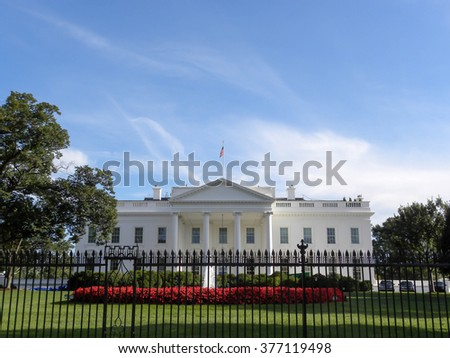WASHINGTON DC (USA) - AUGUST TWENTY ONE, TWO THOUSAND FIFTEEN: Wrought iron black fence in foreground with the White House in the background.