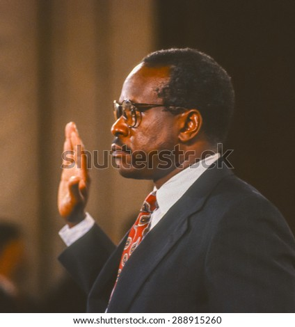 WASHINGTON, DC, USA - Clarence Thomas, Supreme Court nominee, is sworn in before testifying before U. S. Senate Judiciary Committee. September 12, 1991