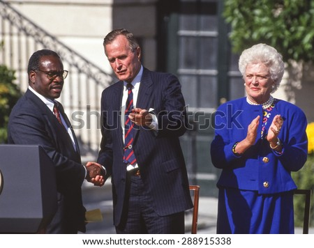 WASHINGTON, DC, USA - Clarence Thomas, Supreme Court nominee, swearing in ceremony at White House, with President and Barbara Bush. October 18, 1991 - stock photo