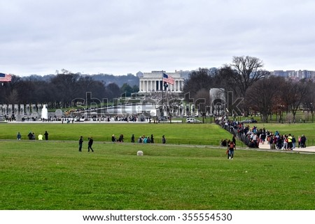 WASHINGTON DC, USA - DECEMBER 27, 2015: Tourists visit the Lincoln memorial at the National Mall in Washington DC. The Lincoln Memorial is an American national monument built to honor Abraham Lincoln.