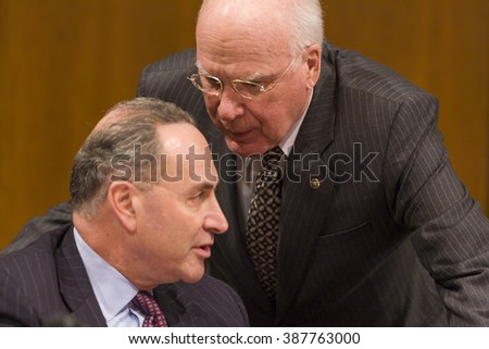 WASHINGTON, DC, USA - JANUARY 10, 2006: U.S. Senators Charles Schumer (D-NY), left, and Patrick Leahy (D-VT), of the the Senate Judiciary Committee, confirmation hearings for Judge Samuel Alito Jr. - stock photo
