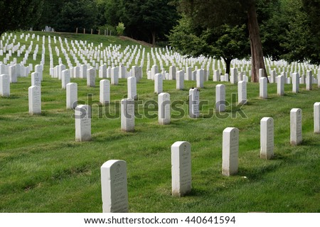 Washington DC, USA - May 31, 2016: Many people visit cemeteries and memorials, particularly to honor those who have died in military service. The gravestones at Arlington National Cemetery. - stock photo