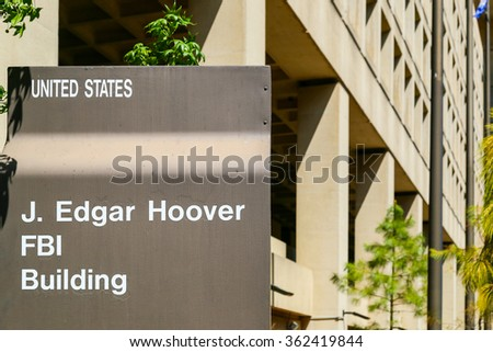 WASHINGTON DC, USA - MAY 2, 2015: Sign displaying J. Edgar Hoover FBI Building, in front of the Headquarters of the Federal Bureau of Investigation. - stock photo