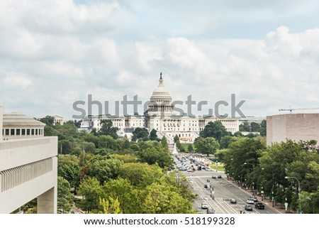 Washington DC, USA - October 2, 2016: Aerial view of United States Congress with traffic cars on pennsylvania avenue on overcast cloudy day