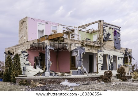 WASHINGTON, ILLINOIS, USA - MARCH 21, 2014: Remains of a house hit by a tornado on November 17, 2013, that destroyed entire neighborhoods there. - stock photo