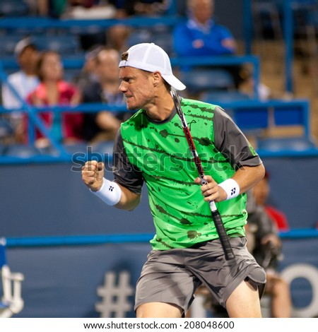WASHINGTON - JULY 29: Lleyton Hewitt (AUS) fist pumps during his winning match against Marinko Matosevic (AUS, not pictured) at the Citi Open tennis tournament on July 29, 2014 in Washington DC - stock photo