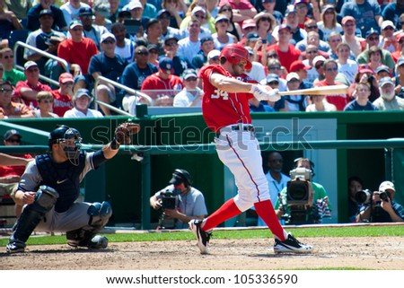 WASHINGTON - JUNE 16:  Bryce Harper at bat during the sold-out Washington Nationals - New York Yankees game, which the Yankees won after 14 innings of play, on June 16, 2012 in Washington, D.C. - stock photo