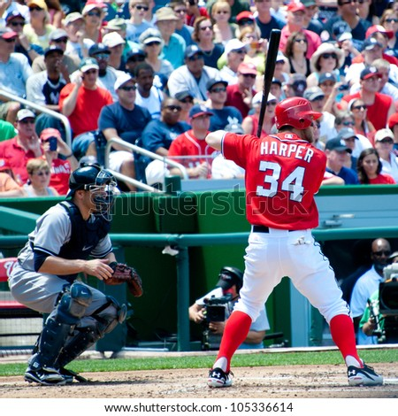 WASHINGTON - JUNE 16:  Bryce Harper at bat during the sold-out Washington Nationals -New York Yankees game, which the Yankees won after 14 innings of play, on June 16, 2012 in Washington, D.C. - stock photo