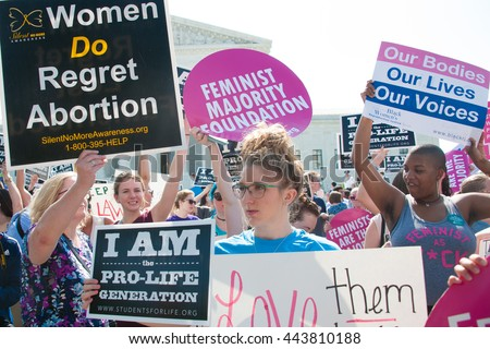 WASHINGTON JUNE 27:  Pro-life and pro-choice activists await the Supreme Courtâ??s ruling on abortion access in front of the Supreme Court in Washington, DC on June 27, 2016