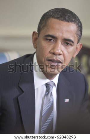 WASHINGTON - JUNE 29: US President Barack Obama at the Oval office June 29, 2009 in Washington, DC - stock photo