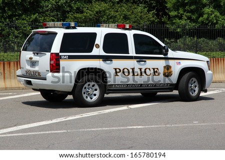 WASHINGTON - JUNE 13: US Secret Service vehicle on June 13, 2013 in Washington. USSS was created in 1865 by Abraham Lincoln and employs 6,700 people (2013). - stock photo