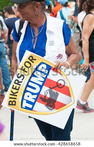 WASHINGTON - MAY 29:  A supporter of presumptive Republican presidential candidate Donald Trump holds a sign at the Rolling Thunder rally on May 29, 2016 in Washington, DC - stock photo