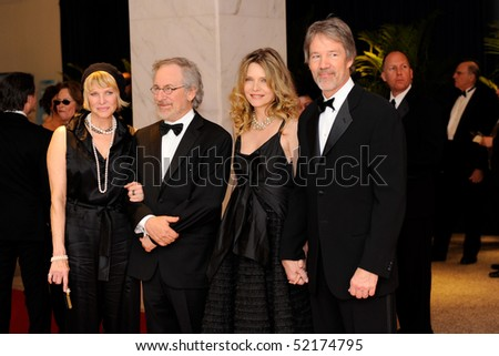WASHINGTON MAY 1 - Cate Capshaw, Steven Spielberg, Michelle Pfeiffer and David Kelley arrive at the White House Correspondents Association Dinner May 1, 2010 in Washington, D.C. - stock photo