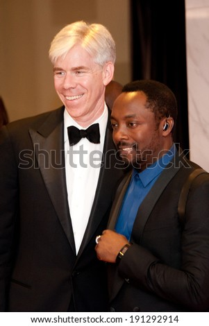 WASHINGTON MAY 3 - David Gregory and Will.I.Am arrive at the White House Correspondents' Association Dinner May 3, 2014 in Washington, DC - stock photo
