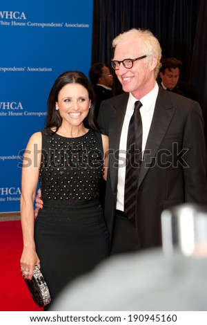WASHINGTON MAY 3 -�� Julia Louis-Dreyfus and husband Brad Hall arrive at the White House Correspondents� Association Dinner May 3, 2014 in Washington, DC - stock photo