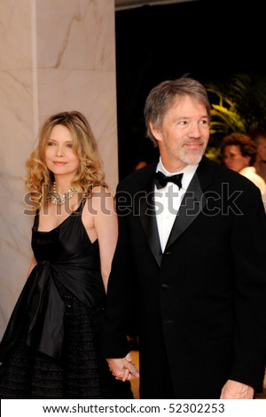 WASHINGTON MAY 1 - Michelle Pfeiffer and husband David Kelley arrive at the White House Correspondents Association Dinner May 1, 2010 in Washington, D.C. - stock photo