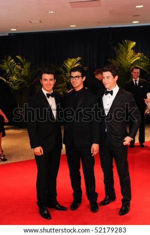 WASHINGTON MAY 1 - The Jonas Brothers arrive at the White House Correspondents Association Dinner May 1, 2010 in Washington, D.C. - stock photo