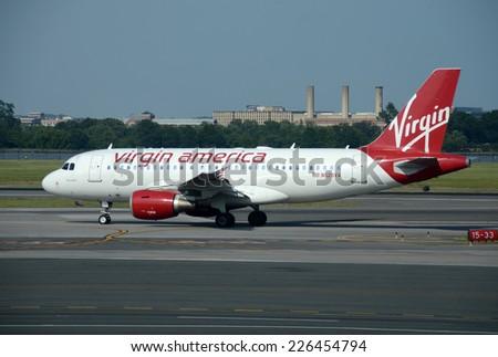 WASHINGTON - MAY 30: Virgin America passenger jet departs from Washington DC to its home base in San Francisco, California on May 30, 2013 - stock photo