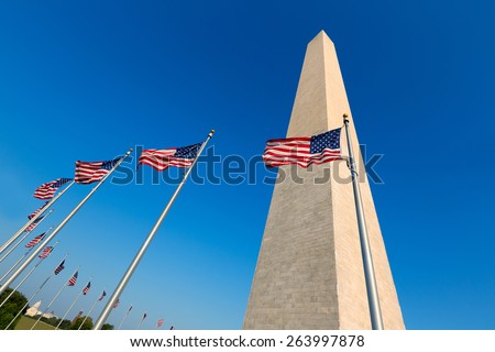Washington Monument and american flags in District of Columbia DC USA - stock photo