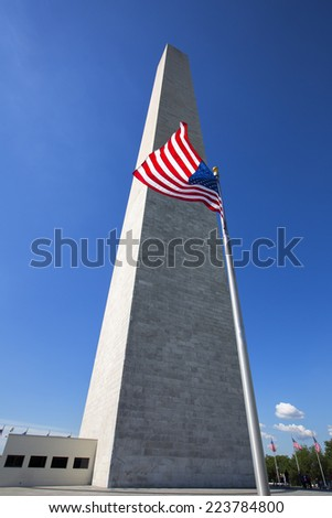 Washington Monument in Washington D,C, United States of America. American Flag flying in front of the monument. - stock photo