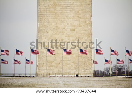Washington Monument with American flags  in, Washington  DC, on a clear winter day, United States