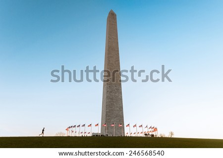 Washington Monument with United States flags