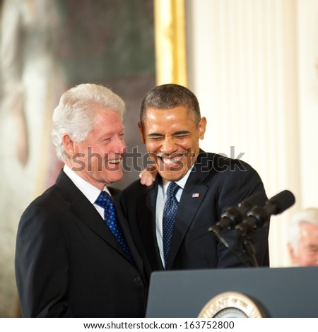 Washington - November 20: Former President Bill Clinton and President Barack Obama share a laugh before Clinton receives the Presidential Medal of Freedom on November 20, 2013 in Washington, DC.  - stock photo