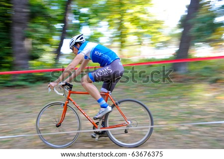 WASHINGTON - OCTOBER 24: A cyclist competes in the DC cyclocross competition on October 24, 2010 in Washington, D.C.