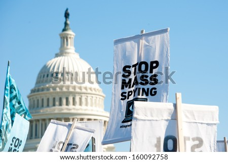 WASHINGTON - OCTOBER 26: Signs held by protesters during a rally against mass surveillance in Washington, DC on October 26, 2013. - stock photo