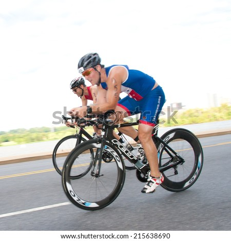 WASHINGTON - SEPTEMBER 7: Cyclists compete in the Nation's Triathlon on September 7, 2014 in Washington, D.C.
