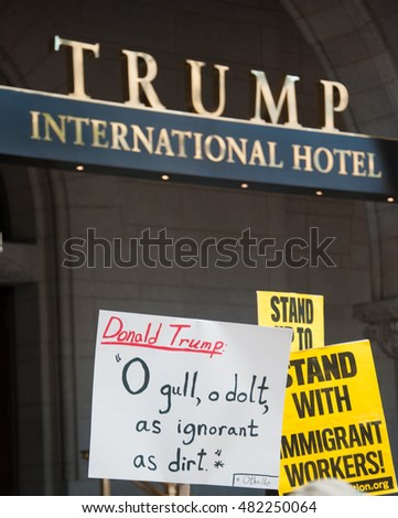 WASHINGTON â?? SEPTEMBER 12:  Signs held by protesters gathered at the soft opening of the Trump International Hotel in Washington DC on September 12, 2016.