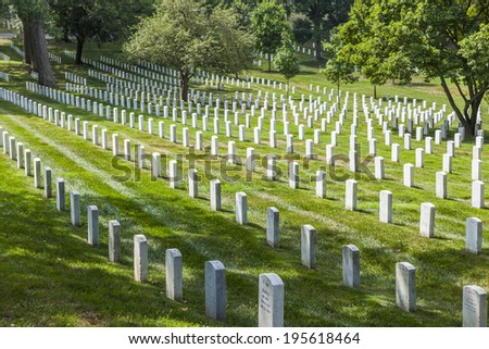 WASHINGTON, USA - JUL 15: Gravestones on Arlington National Cemetery on July 15, 2010 in Washington DC, USA. Headstones mark soldier graves who died in every conflict from Revolution to Sept 11.