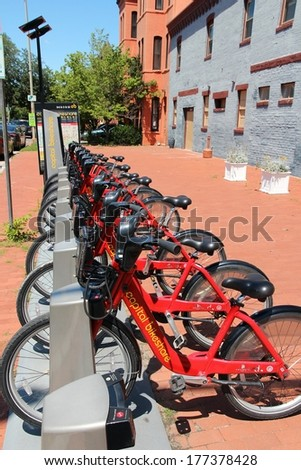 WASHINGTON, USA - JUNE 14, 2013: Bicycle sharing station of Capital Bikeshare in Washington DC. It has more than 300 stations and more than 2 million annual ridership. - stock photo