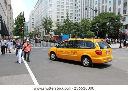 WASHINGTON, USA - JUNE 14, 2013: People cross the street in Washington DC. 646 thousand people live in Washington DC (2013) making it the 23rd most populous US city. - stock photo