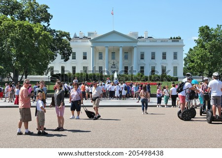 WASHINGTON, USA - JUNE 15, 2013: People visit White House in Washington. 18.9 million tourists visited capital of the United States in 2012.
