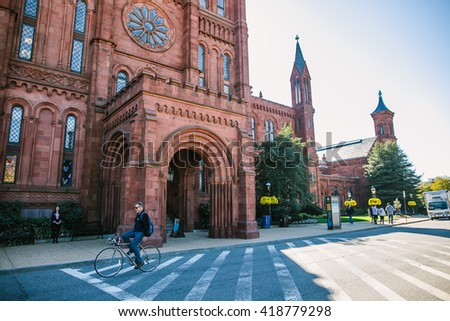 Washington, USA - October 19, 2015: Entrance to Smithsonian Castle in Washington DC. Streets, Architecture and traffic of Washington DC. Washington is the capital of the United States - stock photo