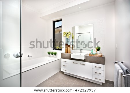 Washroom with a bath tub beside a window and tap  the room is decorated  nicely. Modern Washroom Stock Images  Royalty Free Images   Vectors